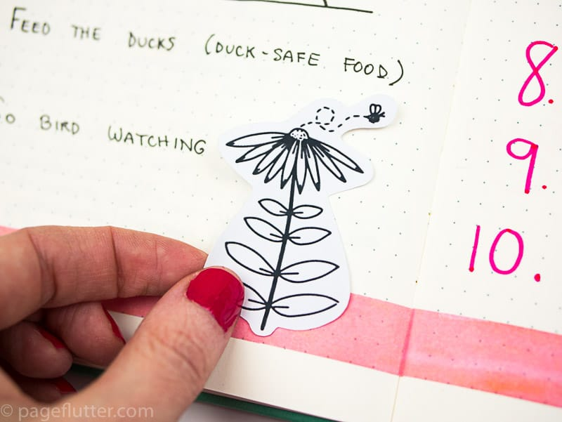15 Printable Floral Planner Stickers to Beautify Your Entire Routine-6 | Floral planner sticker being placed in notebook| pageflutter.com