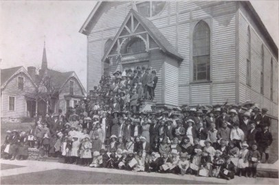 Congregation at St. John's first church building. Photo taken in 1913 before moving into the new brick building.