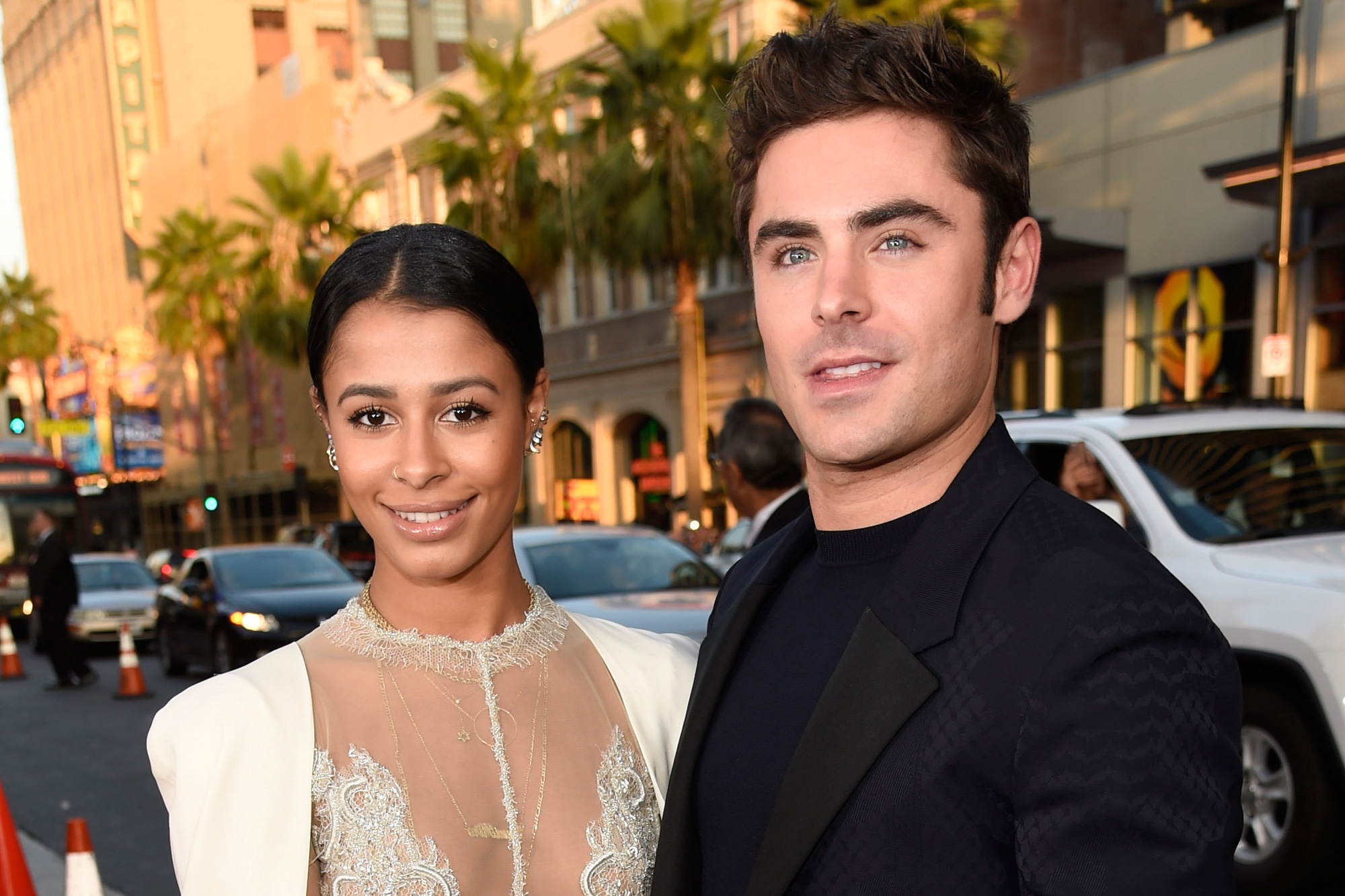 Zac Efron cant keep his lips off girlfriend Sami Miró