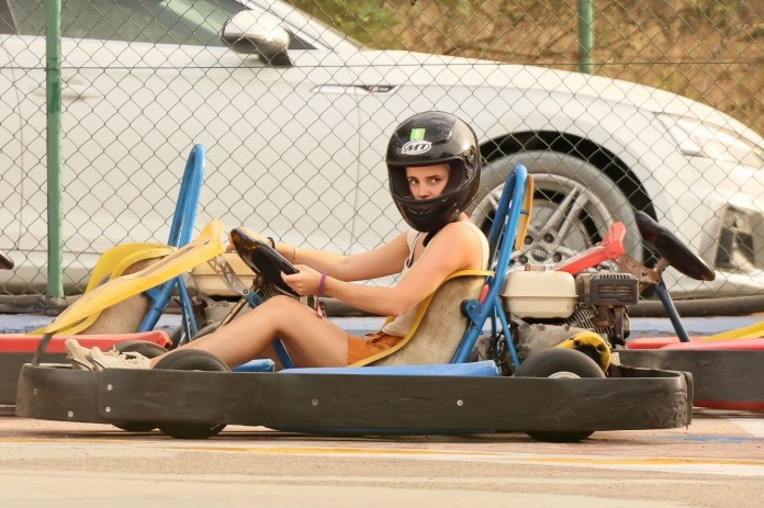 *PREMIUM-EXCLUSIVE* MUST CALL FOR PRICING BEFORE USAGE - Emma Watson has some fun in the sun by Go Karting out in Ibiza