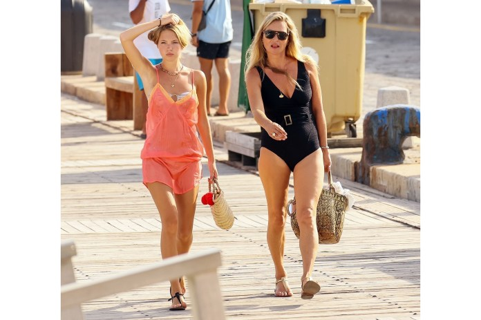 *EXCLUSIVE* Kate Moss looks stunning in a black swimsuit as she's pictured with her daughter Lila Grace Moss