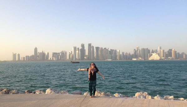 Girl standing in front of the Doha skyline in Qatar