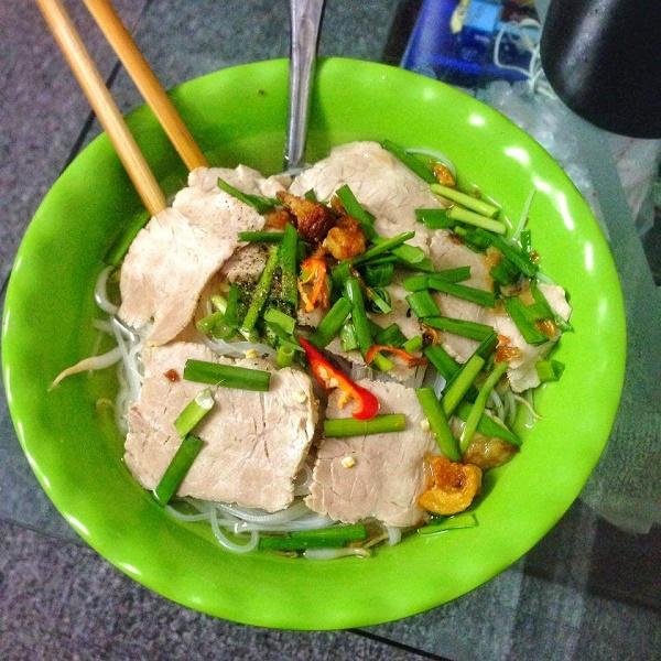 Street food soup noodles with pork, Saigon, Vietnam