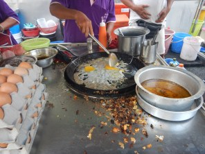 Making fried oyster omelets in Penang
