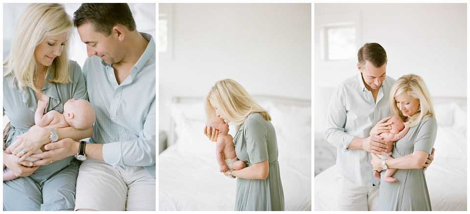 Denver family photographer - mother holding newborn baby and kissing on the head portraits