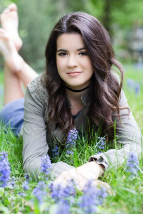 Senior picture of girl laying in a field of flowers