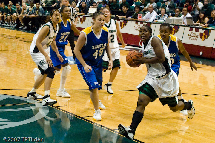 UH Wahine Senior Janevia Taylor drives to the basket on Senior Night
