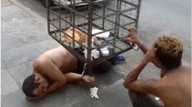 Presos são algemados em lixeira após horas dentro de viatura, por falta de cadeia