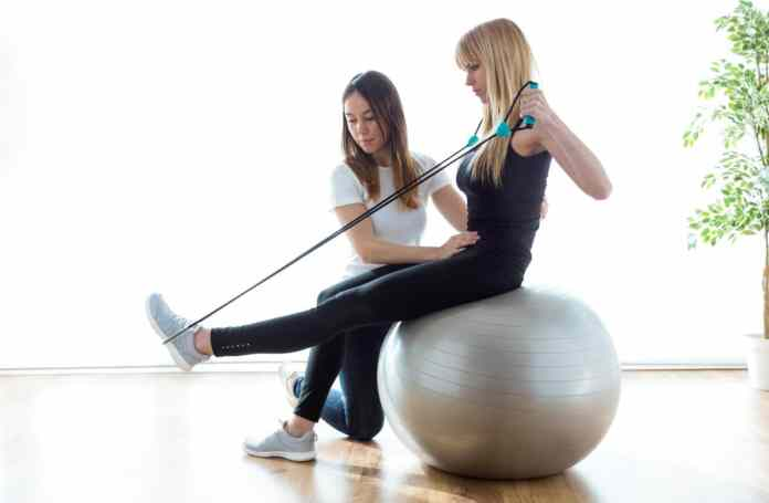 Manage Back and Neck Pain as an Athlete physical therapist treating athlete