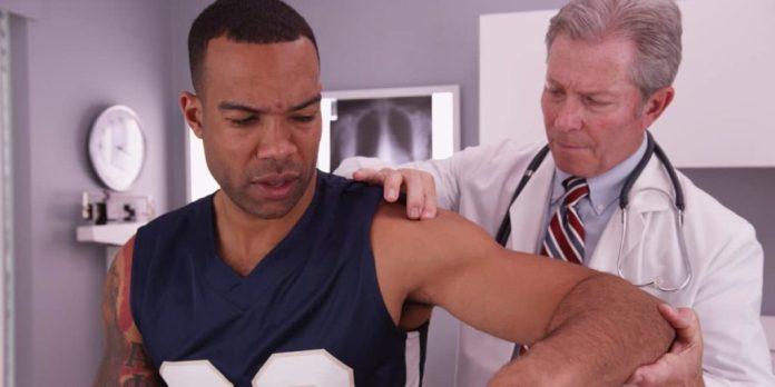 doctor treating athlete's back pain