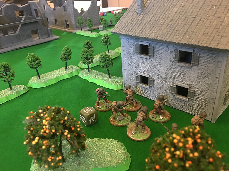 The GI unit debate whether to assault the Germans in the house or run passed them