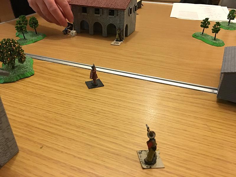 Two gunmen advance towards the house