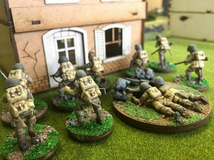 The second US Airborne Squad seeks cover behind the house