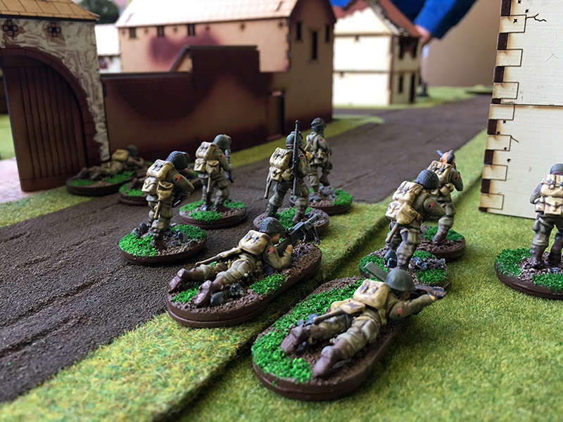 US First Squad advance towards the road
