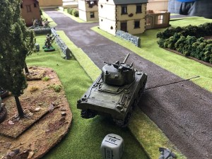 The Sherman advances from the right flank