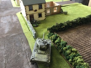 The Sherman trying to machine gun the German flamethorwer