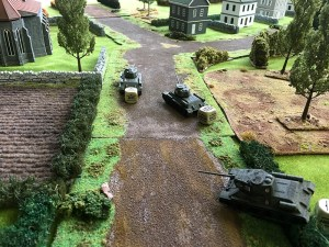 The Russians advance down the road toward the church