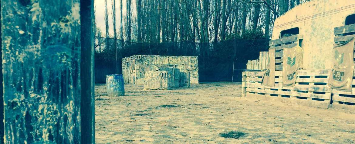 A picture of the paintball field at Paintball Mechelen. Picture contains the center trailer and the famous bunker. Paintball Mechelen - Where fun and tactics meet