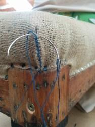 Stitching corners of seat upholstery