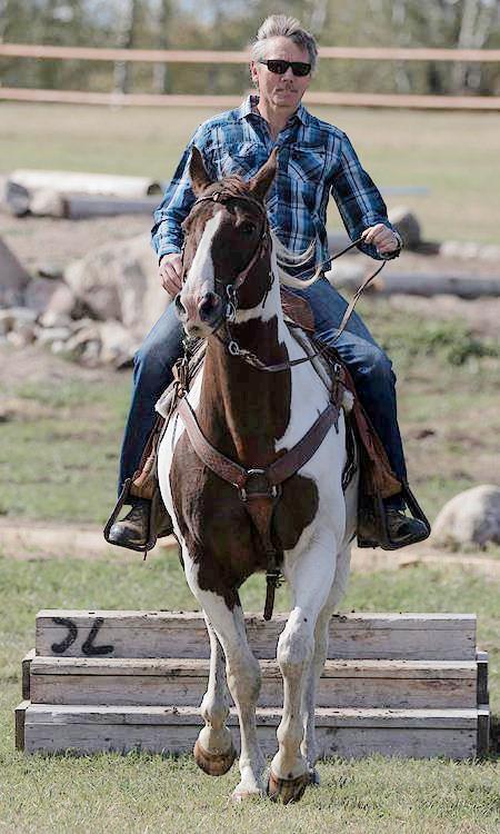 Ralph Flegg riding at outdoor trail course