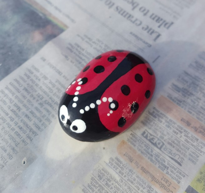 Full step by step rock painting guide: Completely finished rock.