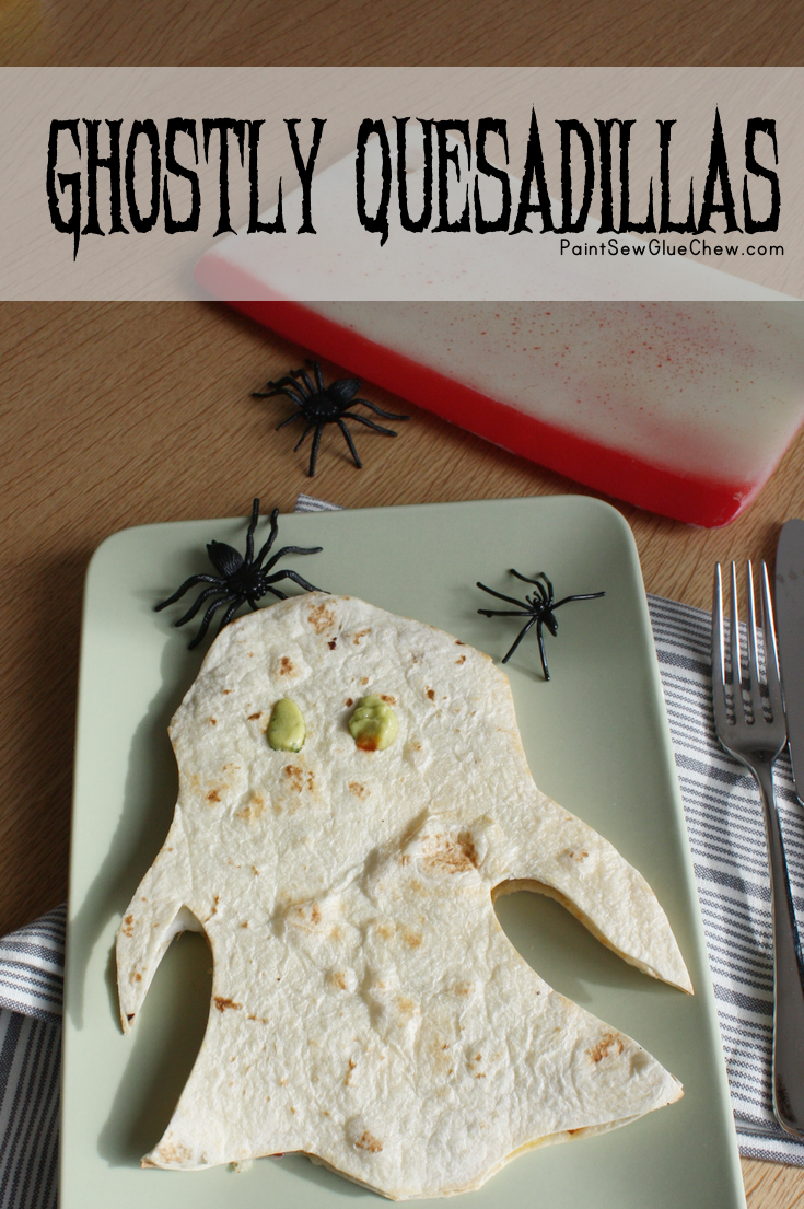 Quesadilla in the shape of a ghost with spiders and words