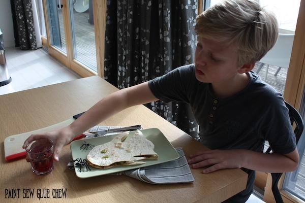 boy eating a ghost quesadilla