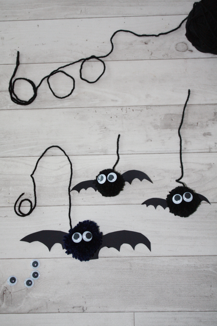 Pom Pom Bat decorations and boo written in wool