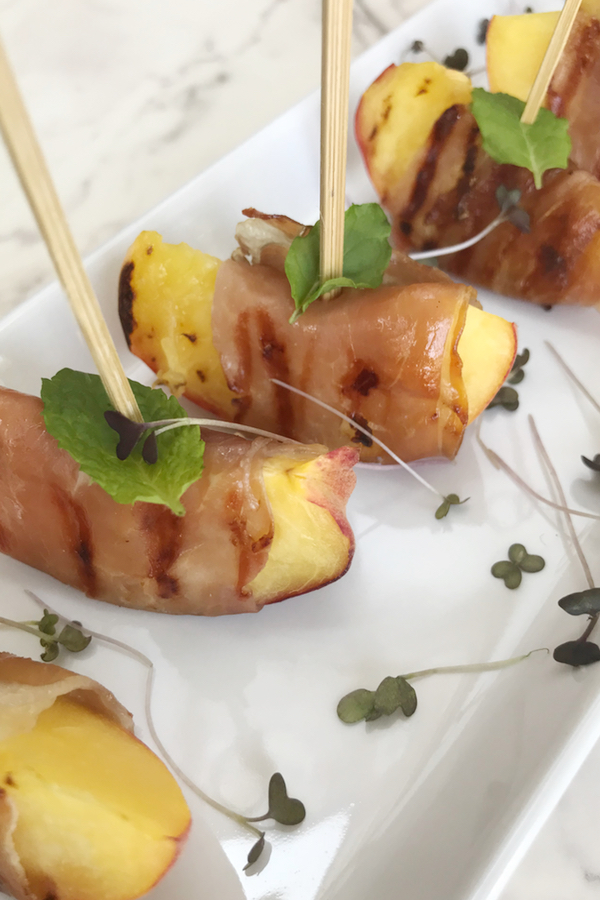 Peach and parma ham canapes