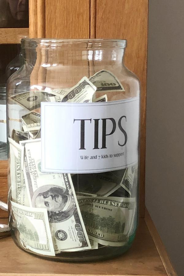 Tip jar in casino at speakeasy party.
