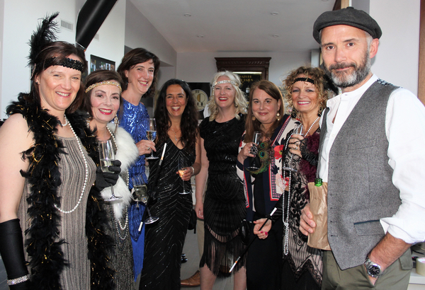 Party guests in 1920s clothes at prohibition party