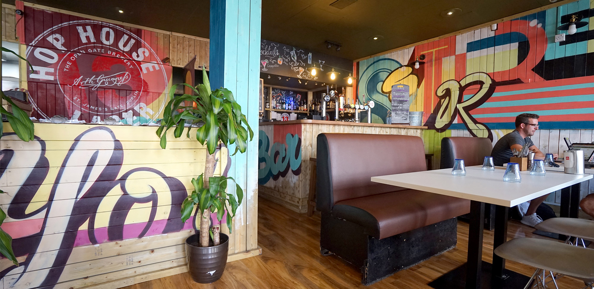 Supergraphics and Photorealistic Mural in Street Bar & Restaurant Bournemouth by Paintshop Studio