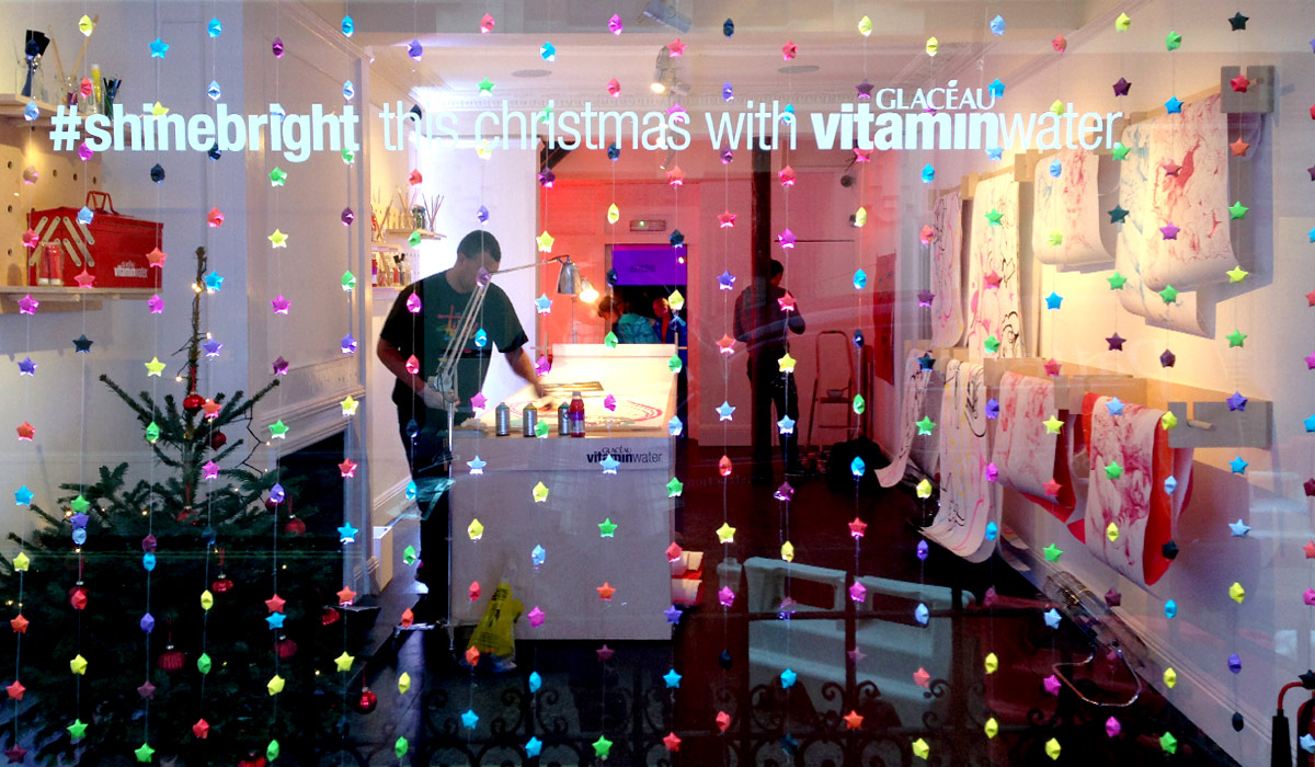 VITAMIN WATER POP UP CHRISTMAS WRAPPING PAPER LIVE ART EVENT LONDON PAINTSHOP