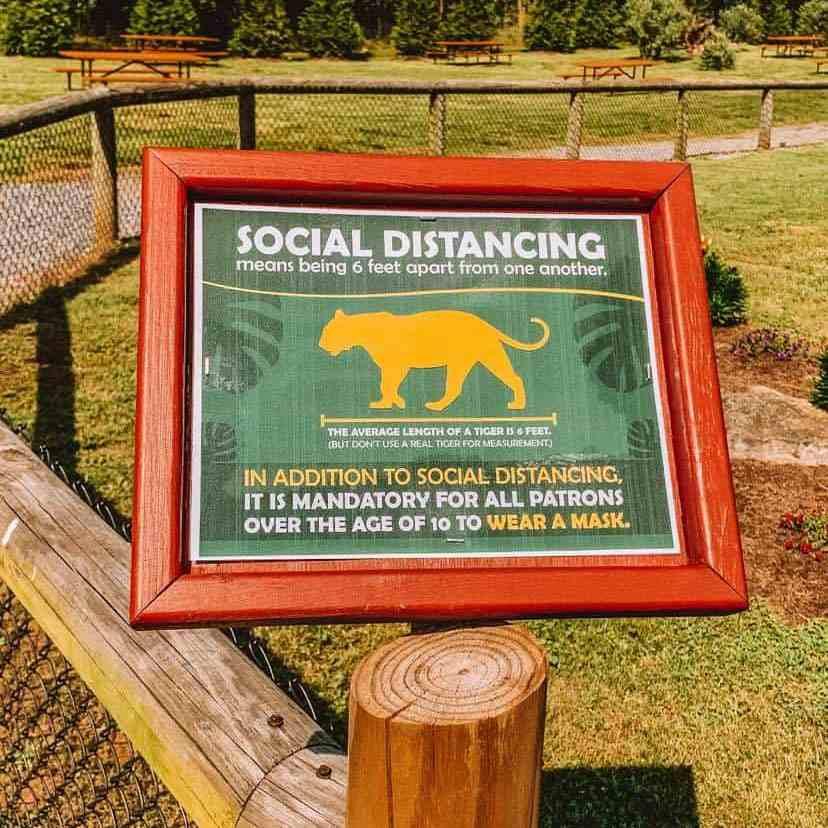 Social distance sign at drive through safari park