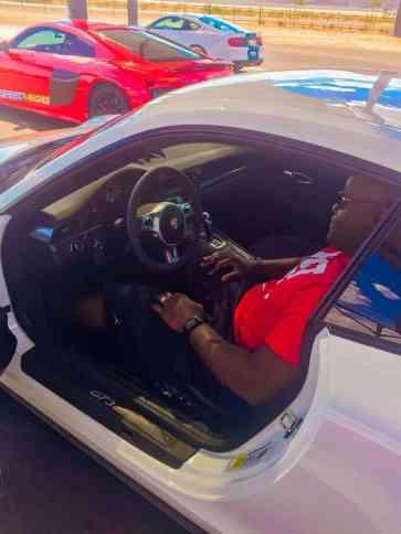 Ty sitting in the Porsche GT3 at Speedvegas.
