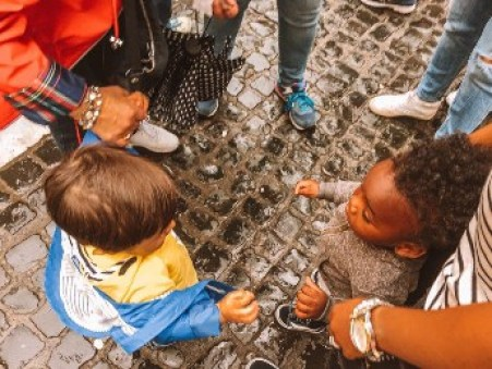 Toddlers at play at Trevi Fountain in Rome