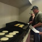 fipping pancakes at 2017 Maple Syrup Festival Saugeen Bluffs