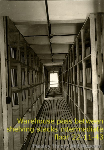 Warehouse pass between shelving stacks intermediate floor 22-11-43