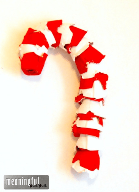 A custom candy cane made of upcycled egg cartons.