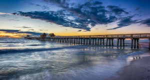 Sunset over Naples Pier, Florida. (Photo by Diana Robinson, Creative Commons License)
