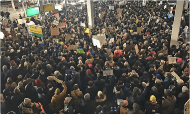 Protesters at the JFK Airport in New York on January 27. (Photo via video stream)