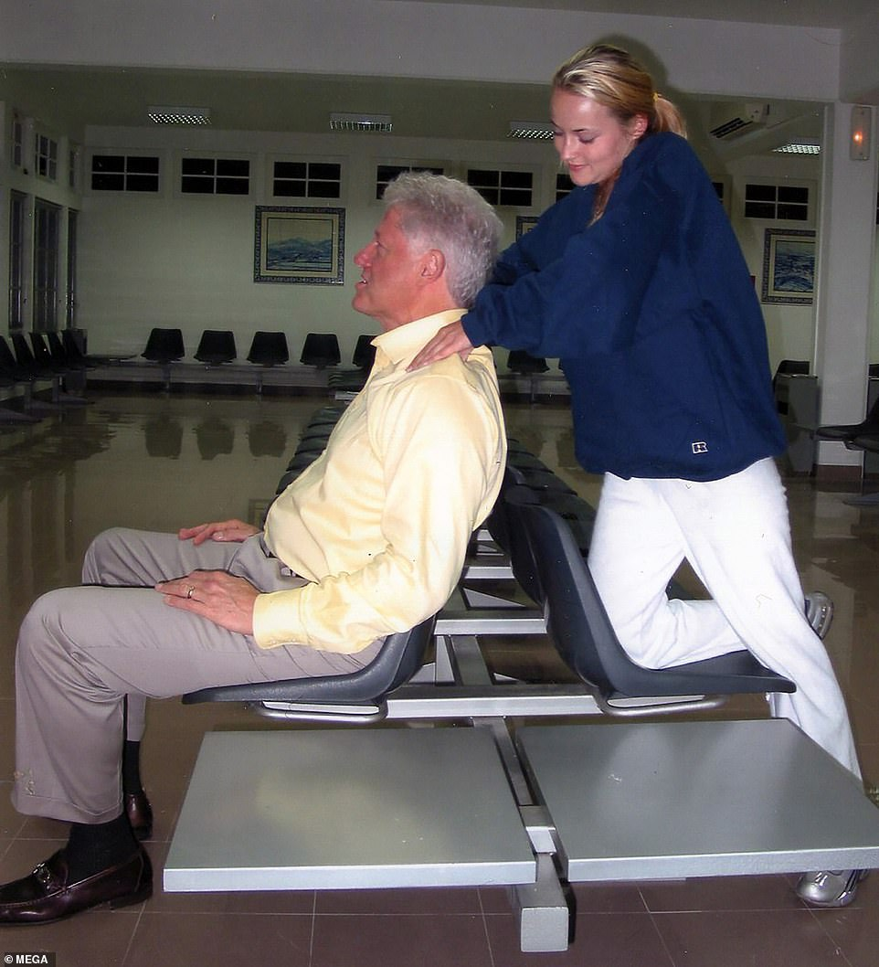32093408-8639501-Bill_Clinton_is_seen_enjoying_a_neck_massage_from_a_Jeffrey_Epst-a-27_1597775965119.jpg