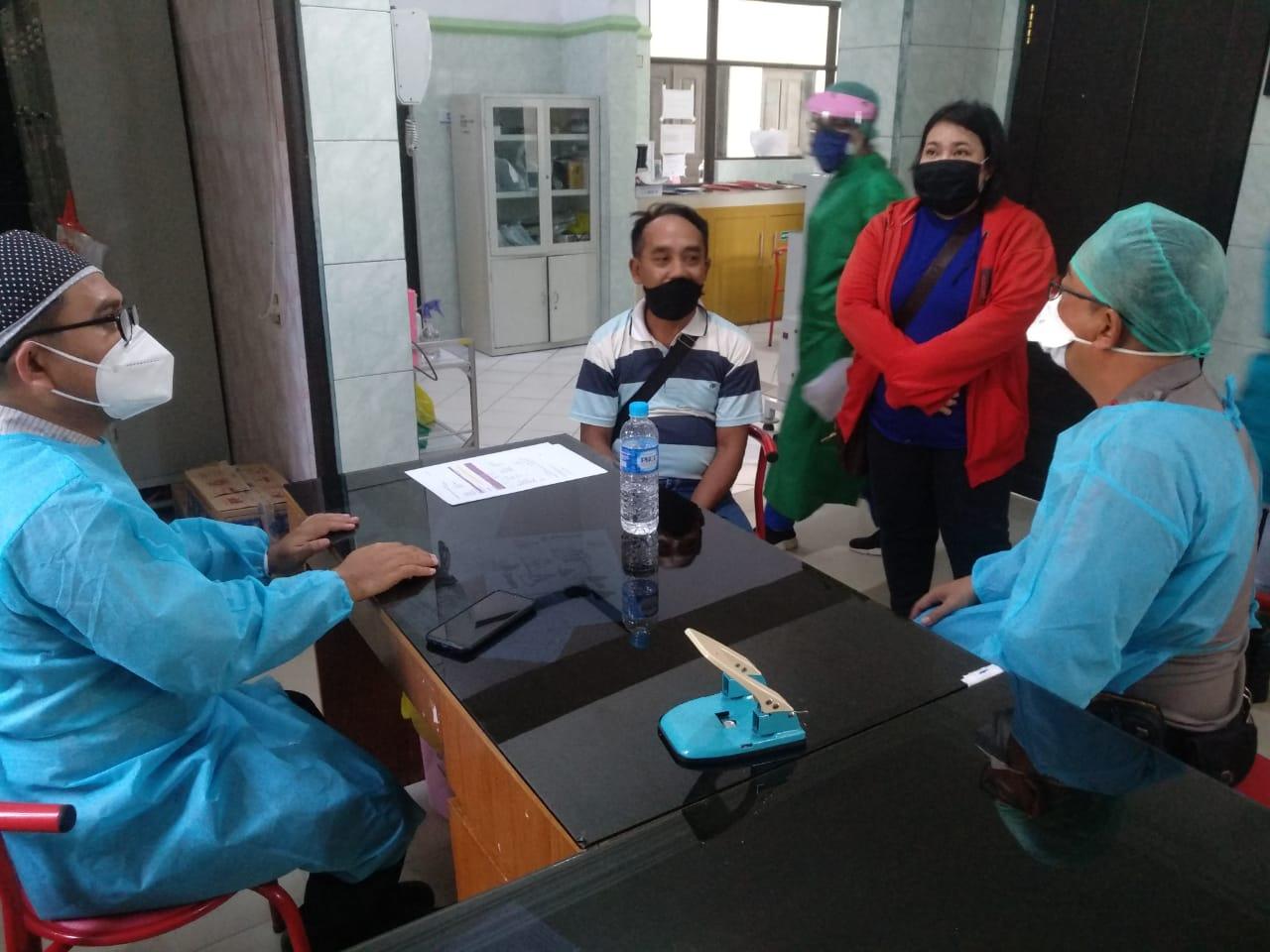 Kapolsek Pahandut Sosialisasikan Prosedur Pemakaman Pasien Suspek Covid-19