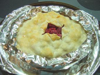 Par-baked pie with foil strips