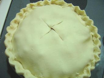 Top crust added to pie