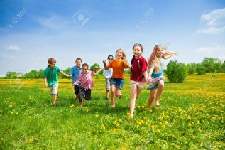 20981386-Large-group-of-kids-running-in-the-dandelion-spring-field-Stock-Photo