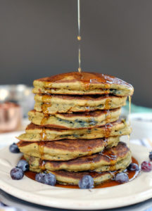 These paleo blueberry pancakes are the perfect way to ease into your weekend. Simple and fresh with blueberries, maple syrup and butter - yum! Paleo and Gluten-Free. | realsimplegood.com