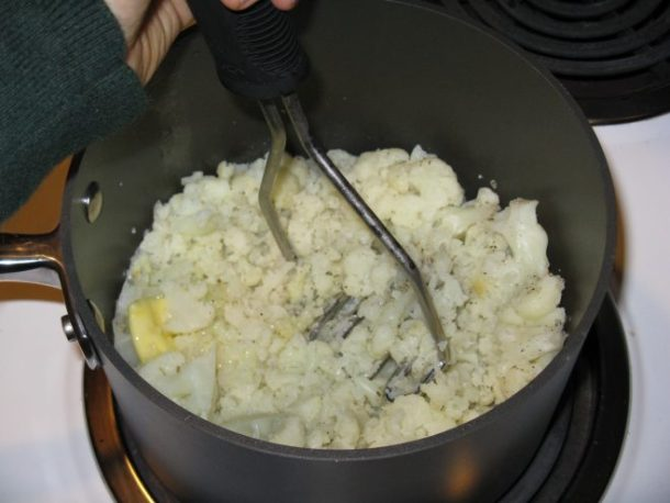 I had to mash my cauliflower old school style. There's something wrong with the motor in my food processor, so the blade doesn't spin properly. It's probably my fault because it's just a small, 4-cup processor that I often over-pack. For things like mashed cauliflower, I have to work in batches.