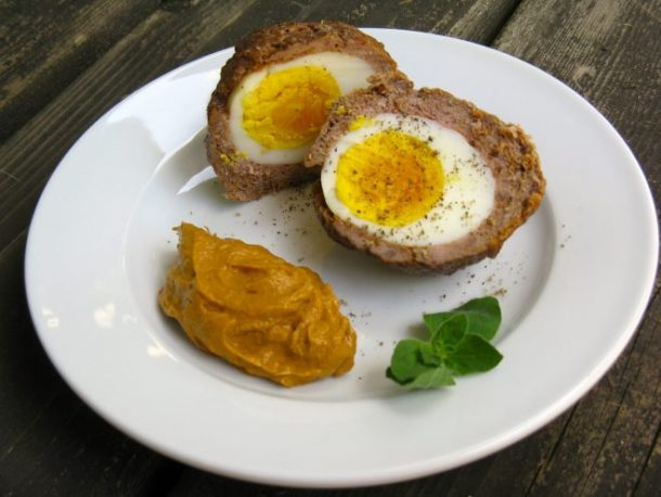 Spicy scotch eggs with creamy bacon sauce.