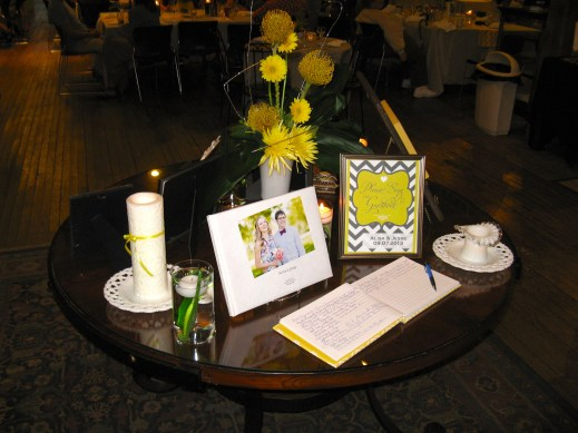 The guest book table. The backside had photos of grandparents and a gift for each guest. I didn't get a photo, but the gift was a magnet made from a bike chain with a picture of a bike inside that said, Live Simply. There was a tag attached to each one that said with love, Alisa and Jesse.